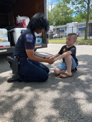 Trey Elliot, 7, meets and prays for several Tulsa police officers amid the unrest in the city and across the country over the death of George Floyd -- June 3, 2020