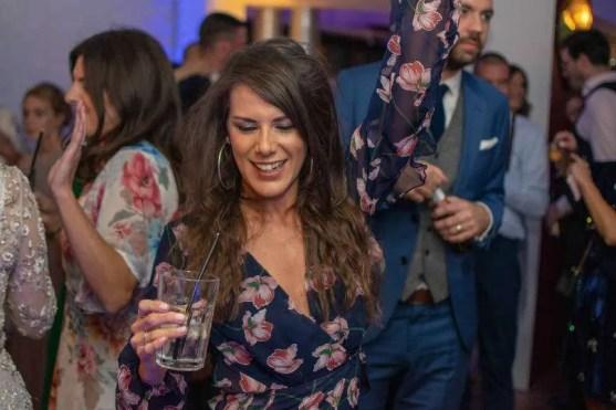 A female wedding guest dancing