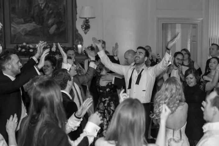 A black and white photo of dancing at a wedding in Essex