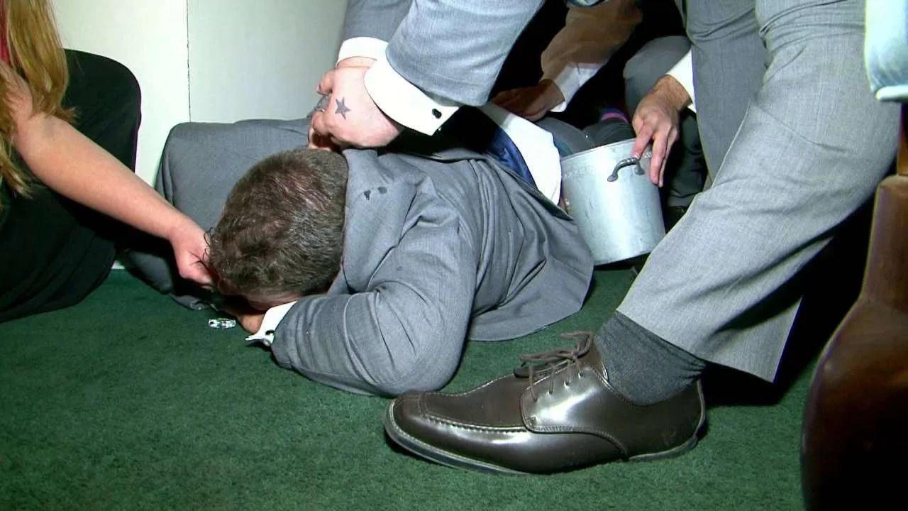 A drunk groom at a wedding