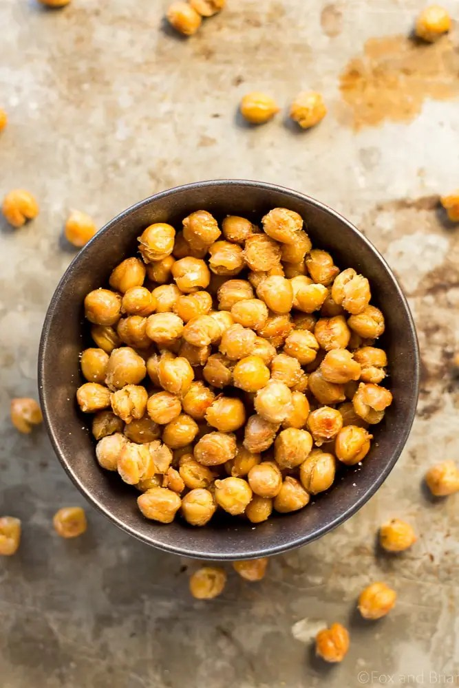 These Crispy Truffle Roasted Chickpeas are an addictive snack that is high in protein and fiber and low in carbs. Great for an evening snack instead of popcorn.