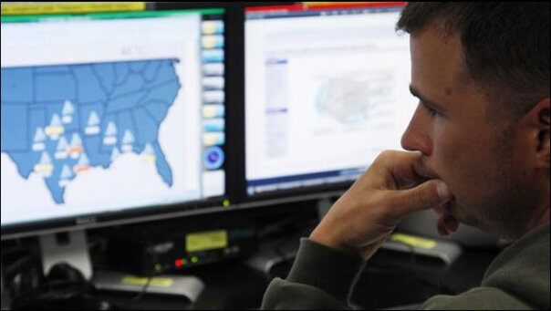Josh Mayeux, network defender, works at the Air Force Space Command Network Operations & Security Center at Peterson Air Force Base in Colorado Springs, Colorado July 20, 2010.