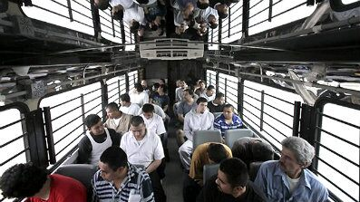 May 25, 2010: Shackled Mexican immigrants ride in a U.S. Immigration and Customs Enforcement bus for deportation in Harlingen, Texas.
