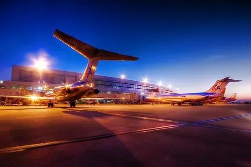 airplanes waiting at gate