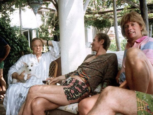 Zeffirelli with one of his beloved dogs, Rudolf Nureyev and Barry Joule