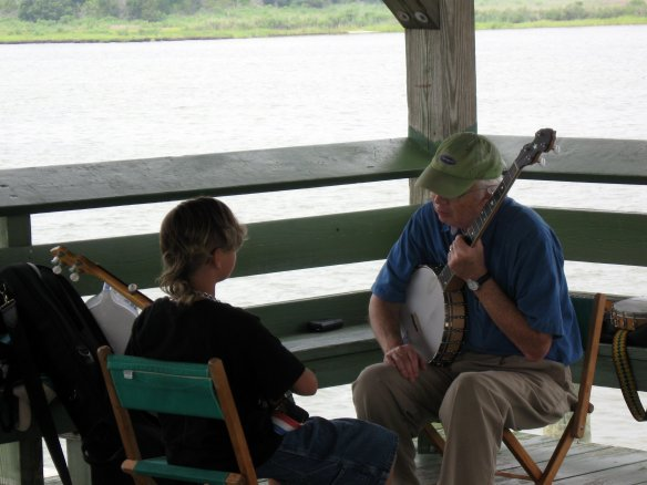 Dear Old Dad gives a banjo lesson.