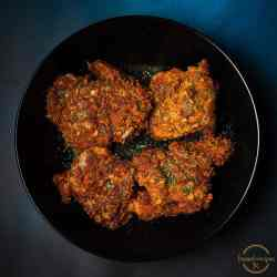 Spicy_Oats_Crusted_Chicken_Thighs_in_a_black_plate_square_image