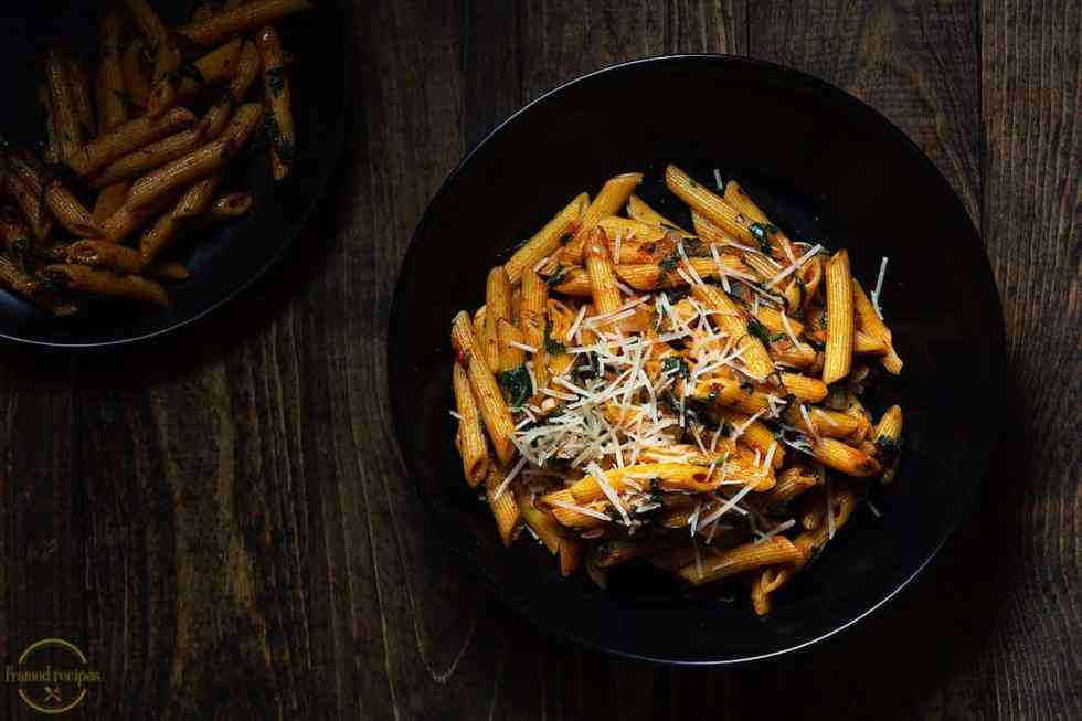 Cajun Spiced Spinach pasta in a black bowl horizontal picture
