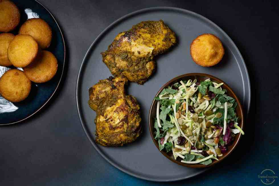 chicken thighs cooked on stovetop with mint and cilantro marinade served with a salad and muffin
