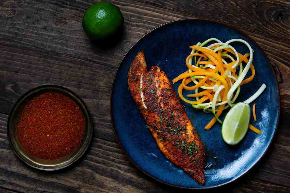 blackened tilapia served with spiralized vegetables.
