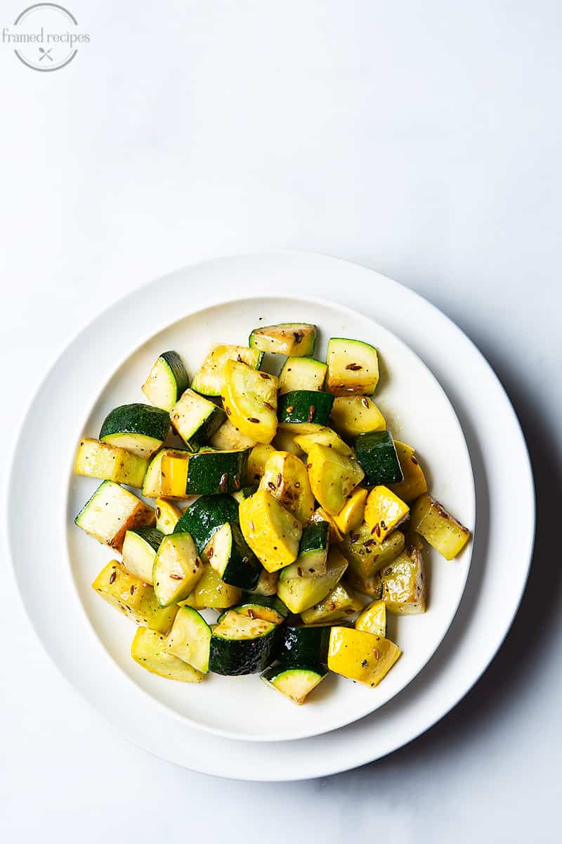 sautéed zucchini with cumin seeds and black pepper.