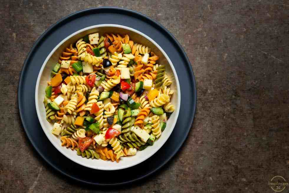 delicious pasta salad ready to be refrigerated.