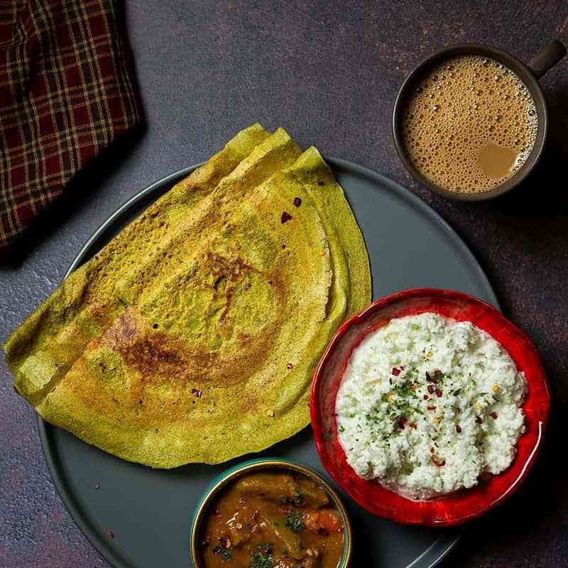 oats and moong chilla served with chutney , sambhar & coffee