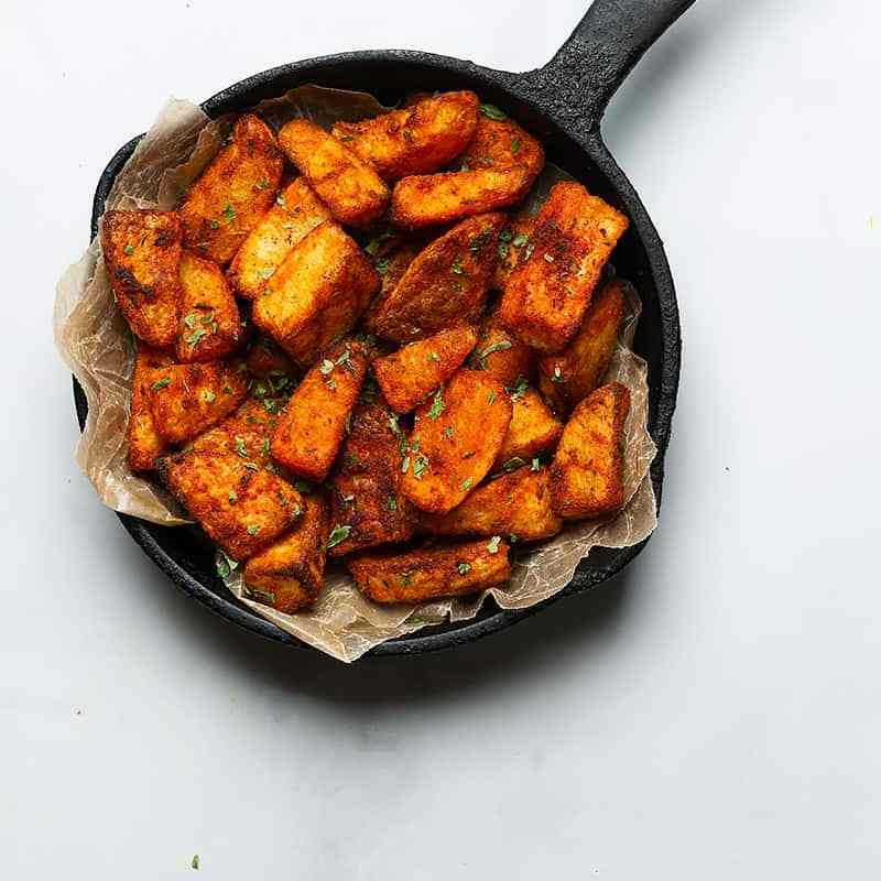air fried potatoes shown in a cast iron skillet