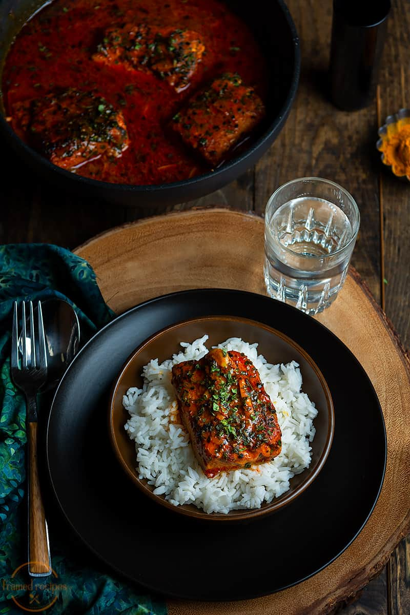 fish curry served with steamed rice
