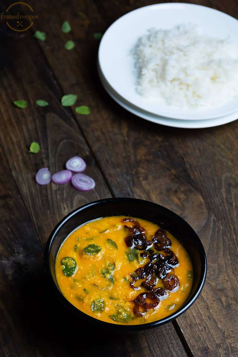 muringa ila parippu curry garnished with fried shallots served with steamed rice