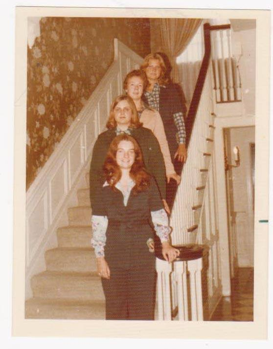 Some backstory: we went shopping (L.S.Ayres in Indy) for the pant suits. I already had a dark green one, so I picked beige (sort of buff). We sewed on the embroidered patches. Going up the staircase: Lorie Freeman (Ermak), Alpha Upsilon; Kathy Lee (Holle), Beta Beta; Nann Blaine (Hilyard), Epsilon Alpha); and Sandra Sarff, Delta Eta. I had two huge gold Samsonite suitcases and a gold corduroy tote for those notebooks. I remember sending a box of clothing home in mid-September. [Nowadays I am a much more efficient packer!].....I think that pantsuit is still in a box in the attic and one of these days I will send it to IHQ for the archives.