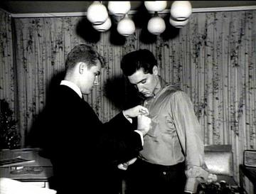 Rick Husky pins a TKE pin on his newest fraternity brother Elvis Presley. (Photo courtesy of Elvis Presley Enterprises)