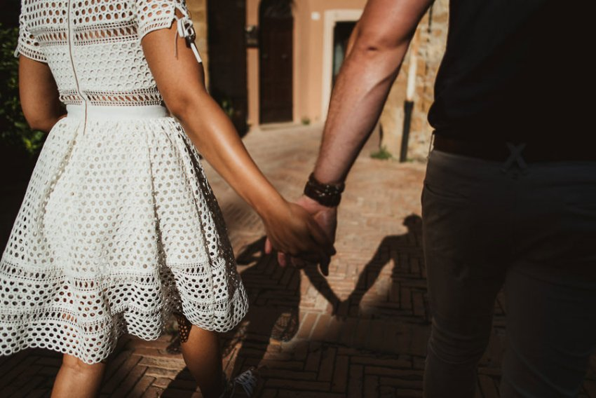 Wedding proposal inspiration hanging hands walking in Italy