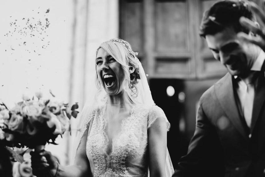 luxury wedding photographer umbria italy htrowing petals