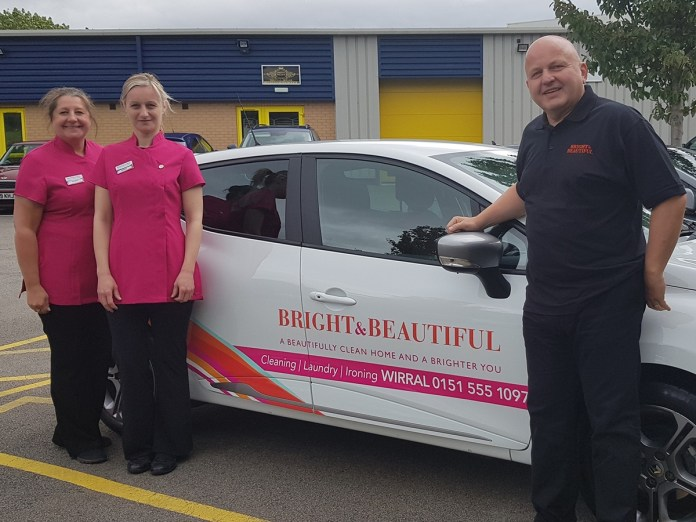 David Harrison of Bright Beautiful Wirral with two new local employees