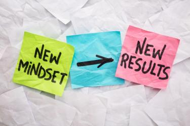 three post it notes with new mindset on one and arrow pointing to new results