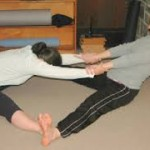 Pair work in forward bend