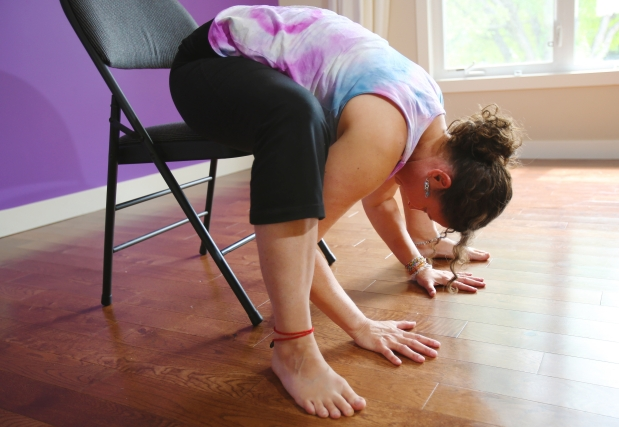 Sit with your legs wide and then come to a forward bend.  Stretch your back.