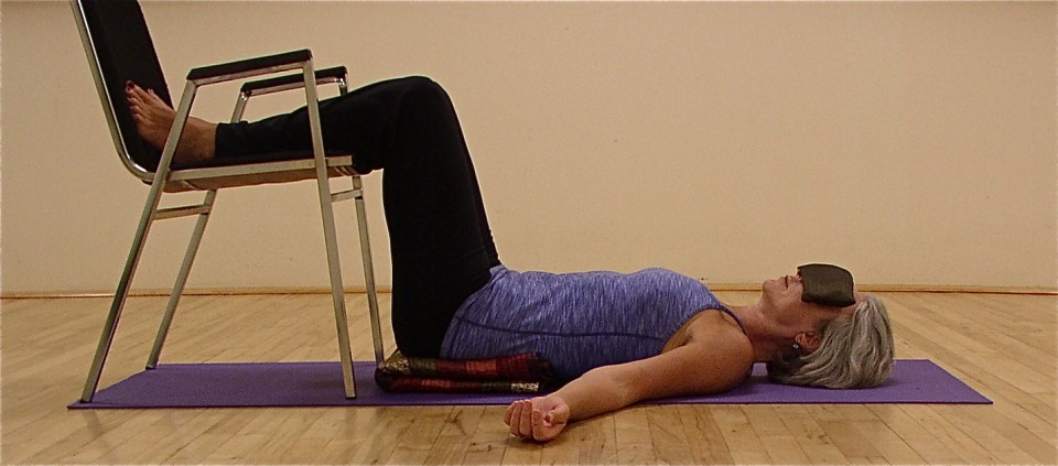 Relaxation pose!  Well, since the chairs were out, this pose took the place of Shavasana.  It feels great to have the legs elevated. The taller you are, the more you may want to scoot away from the chair.  Or you can place a blanket under your calves.  Stay for 5 minutes.