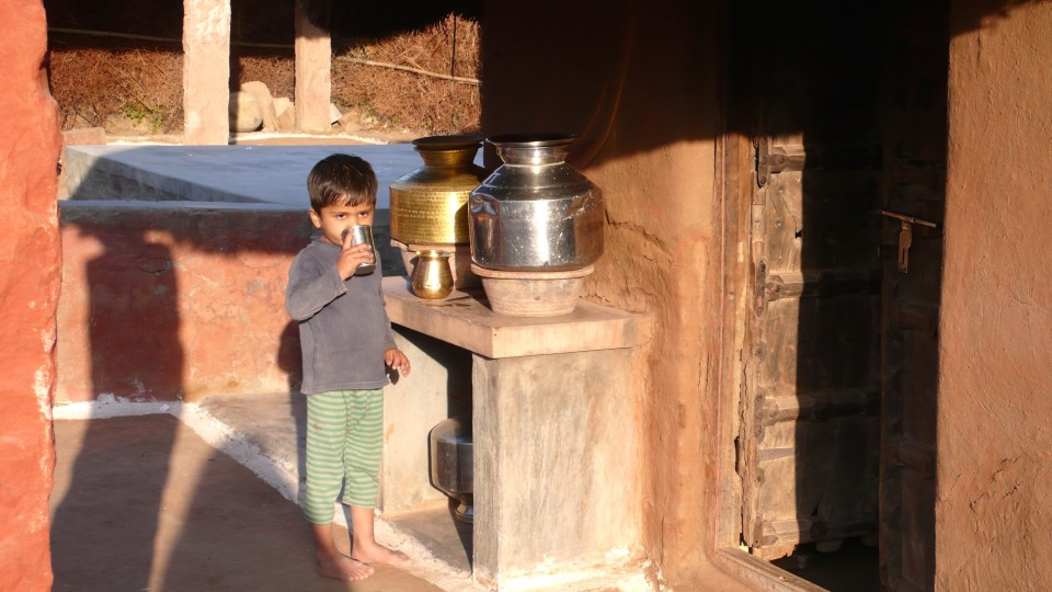 Little boy drinking water, Jodhpur, Rajasthan (weavers' home)