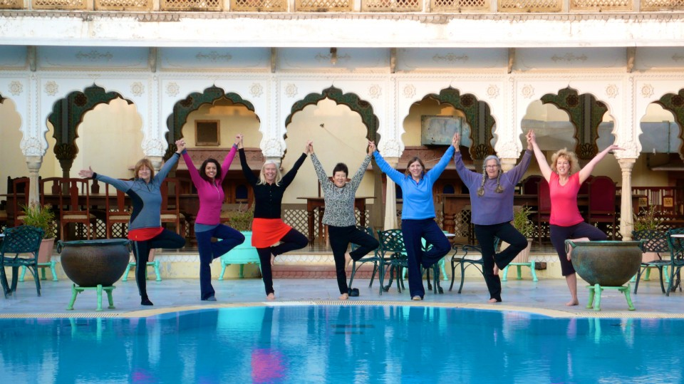 Poolside Yoga at our heritage hotel, a former maharaja palace.