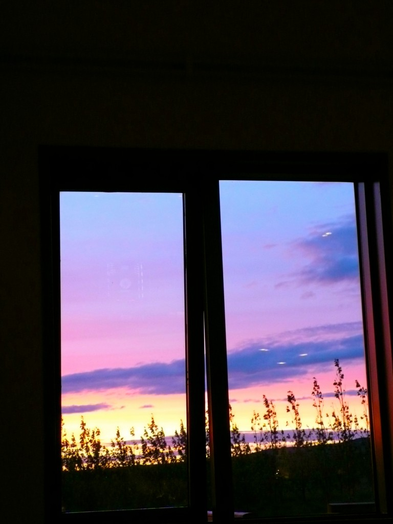 View of sunset from the dining room (one window is open..everything is geo-thermically heated so rooms are cozy warm and open windows bring in some fresh air.)