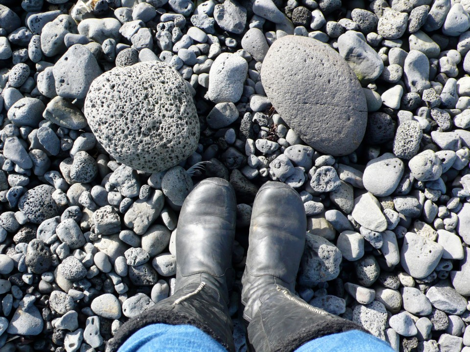 My feet on black lava beach