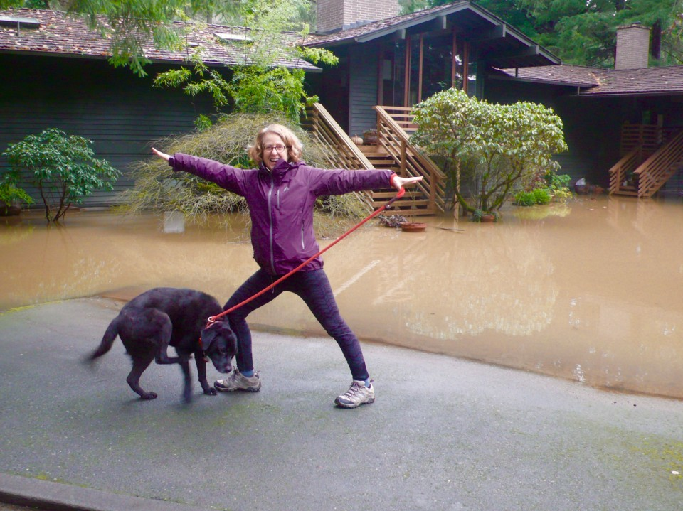 Dayna with Willie in front of the flooded area.
