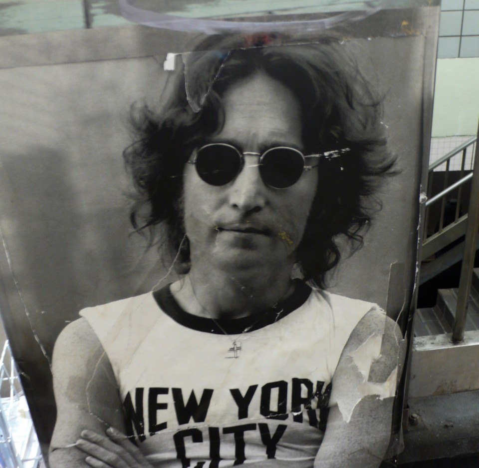 I saw this tattered, torn, and taped together poster of John Lennon in NYC and got a shot of it.