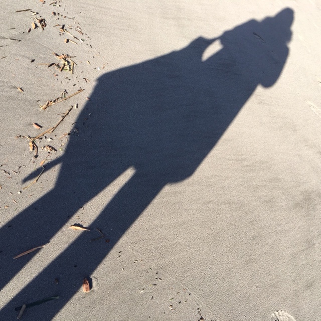 Another long shadow selfie: shadow against unblemished sand