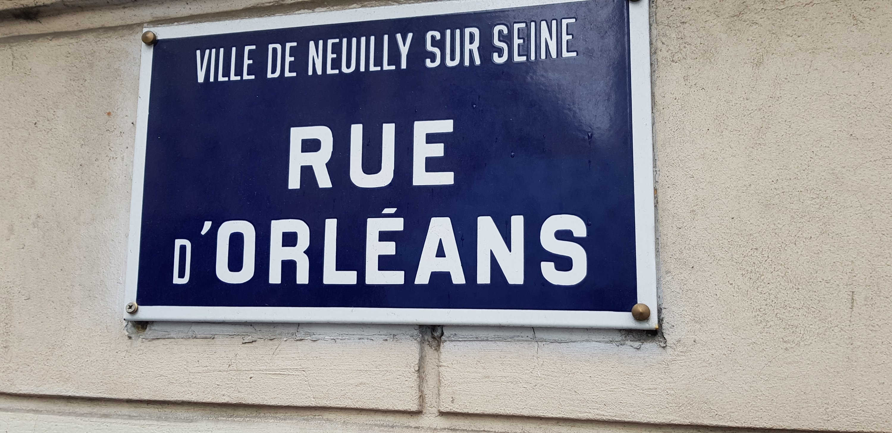 Plaque of the road Rue d'Orleans in Neuilly