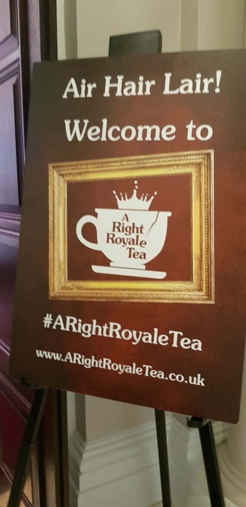 The board at the entrance to the A Right Royale Tea event