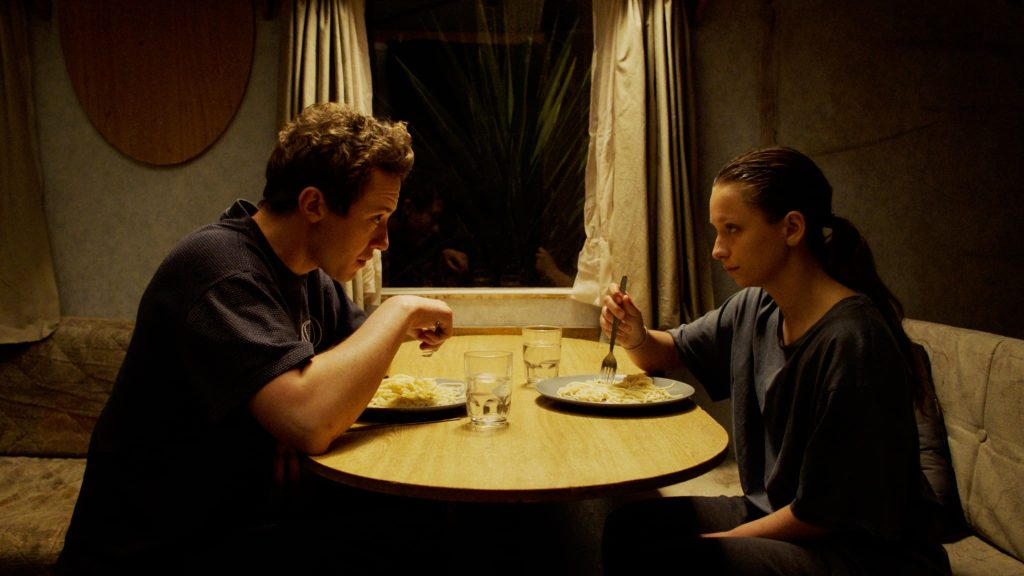 Ruth and Tom eating dinner in the caravan in Make Up
