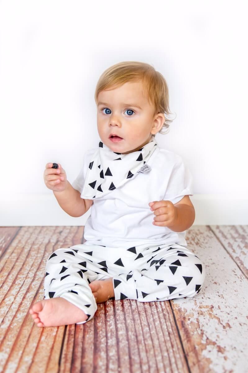Toddler with black triangle bib