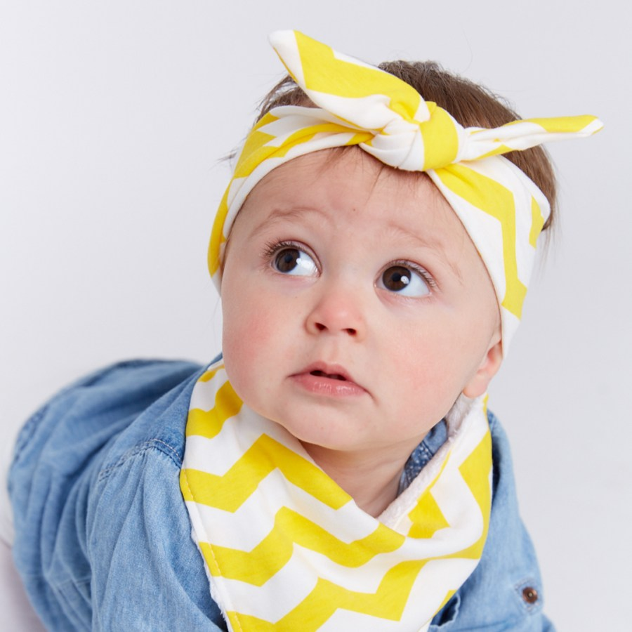 Boy wearing yellow & white chevy Frankie Lola bib and head wrap