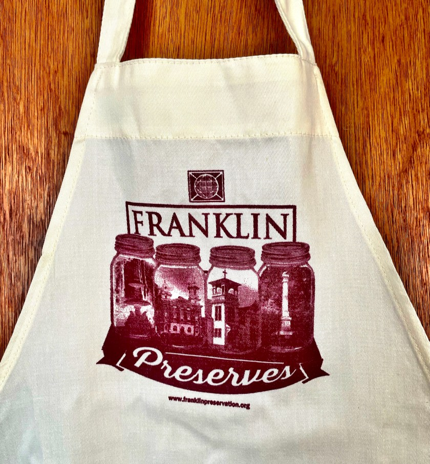 Apron bib showing mason jars with images of historic buildings and landmarks in Franklin, Pa