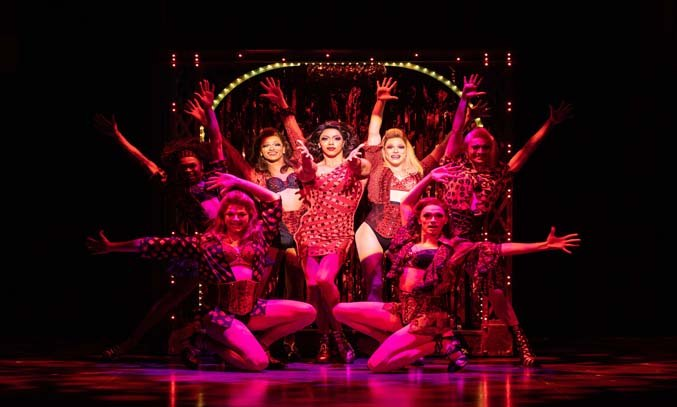 Callum Francis as Lola and the Angels in KINKY BOOTS
