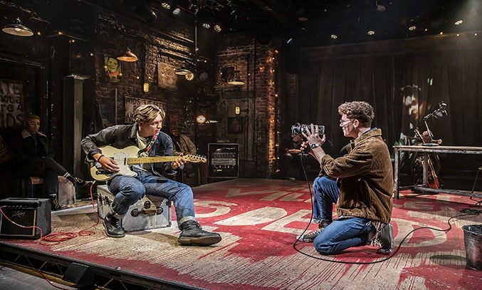 Tom Francis (Roger) and Blake Patrick Anderson (Mark) in RENT at Hope Mill Theatre