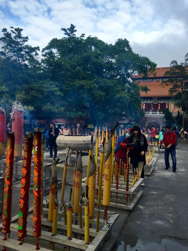 Burning incense at the Po Lin Monastery
