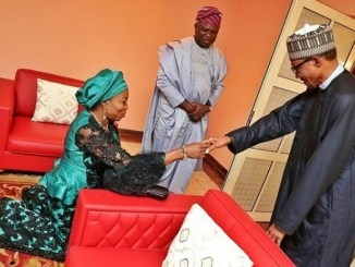 First Lady of Lagos, Bolanle Ambode kneels down to greet President Buhari