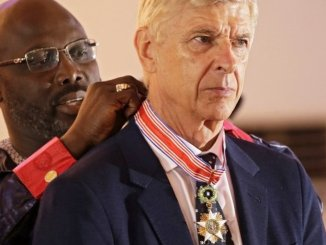 Arsenal's ex-coach Arsene Wenger finally wins a medal, thanks to Liberia's President George Weah