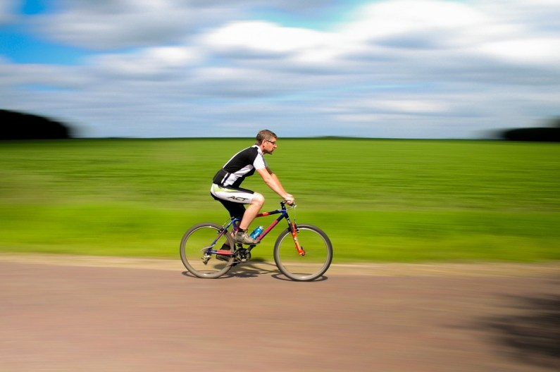 man riding on his bicycle