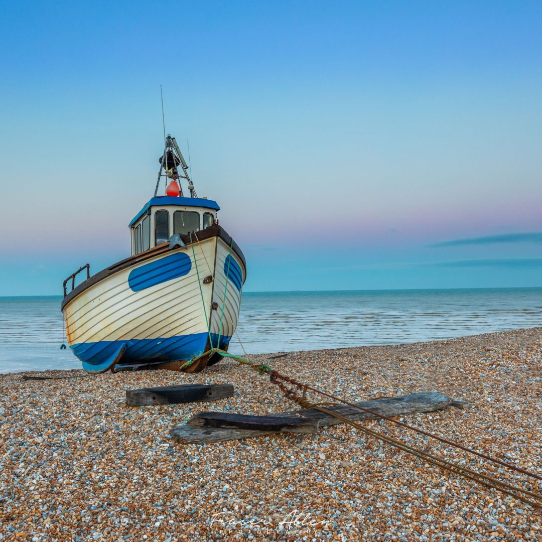 Dungeness fishing boat at sunset