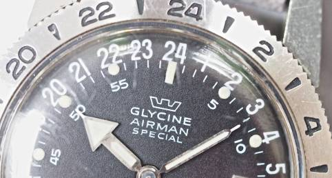 """It's not easy to see on the Glycine Airman, but note the little hole betwen the 2 and 4 of """"24"""" on the dial where the wire comes through"""